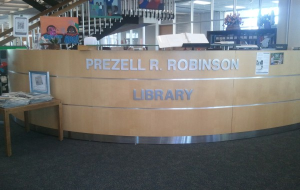 Flat Cut Aluminum lettering for St. Aug's library reception desk